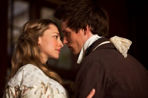 """AMANDA SEYFRIED as Cosette and EDDIE REDMAYNE as Marius in """"Les Misérables."""" Photo: Laurie Sparham. Copyright: © 2012 Universal Studios. ALL RIGHTS RESERVED."""