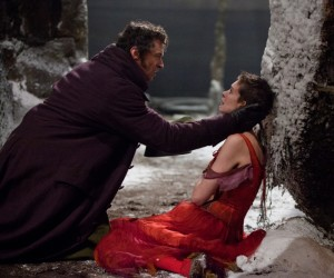 """Jean Valjean (HUGH JACKMAN) embraces a very ill Fantine (ANNE HATHAWAY) in """"Les Misérables,"""" the motion-picture adaptation of the beloved global stage sensation seen by more than 60 million people in 42 countries and in 21 languages around the globe and still breaking box-office records everywhere in its 28th year.  Photo:: Laurie Sparham. Copyright: © 2012 Universal Studios. ALL RIGHTS RESERVED."""