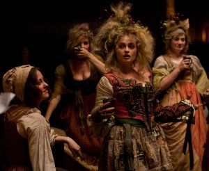 """(Center) Madame Thénardier (HELENA BONHAM CARTER) rules her inn in """"Les Misérables."""" Photo: Laurie Sparham. Copyright: © 2012 Universal Studios. ALL RIGHTS RESERVED."""